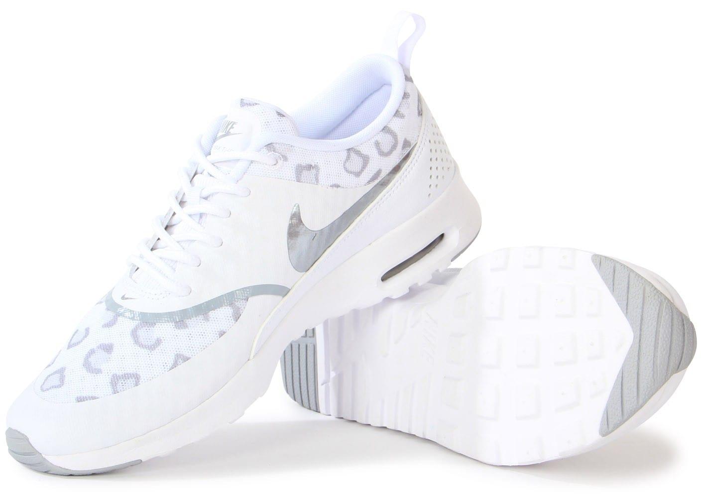 d61712ef96ea Cliquez pour zoomer Chaussures Nike Cortez Basic junior léopard blanche et rose  vue extérieure ... NIKE Vêtements Tee-shirt pour Homme - Nike SB Dry Leopard  ...